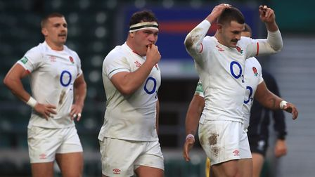 England's Jonny May (right) and Jamie George (centre) during the Autumn Nations Cup match at Twickenham Stadium, London.