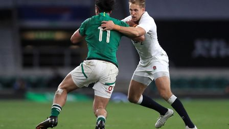 Ireland's James Lowe is tackled by England's Max Malins (right) during the Autumn Nations Cup match at Twickenham Stadium,...