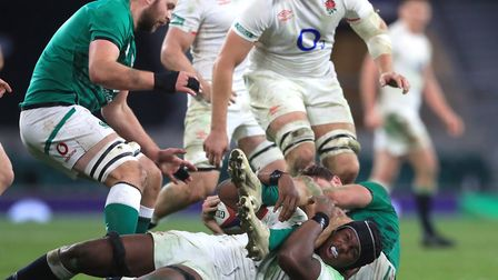 England's Maro Itoje (floor) makes a tackle during the Autumn Nations Cup match at Twickenham Stadium, London. Picture...