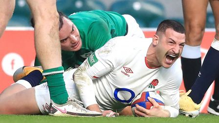 England's Jonny May (right) celebrates scoring his side's first try during the Autumn Nations Cup match at Twickenham...