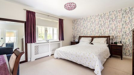 One of the five bedrooms in the main house. Picture: Hamptons