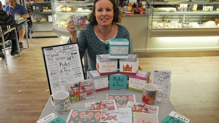 Hannah Sessions with her St Albans collection of mugs, postcards, tea towels and other stationery