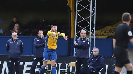 St Albans City's bench looks on as Tom Bender takes a throw against Hungerford Town. Picture: PETER SHORT