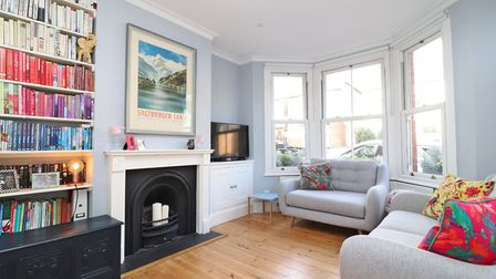 There is a charming lounge with feature fireplace and sash bay window. Picture: Paul Barker Estate Agents