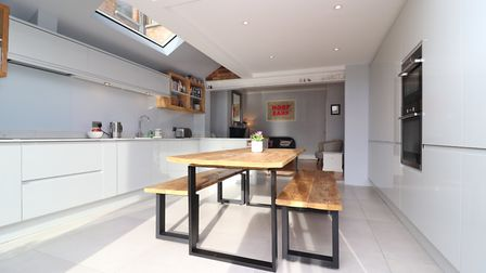 The stylish kitchen is finished to a very high standard and includes a superb peninsula with recessed storage. Picture...
