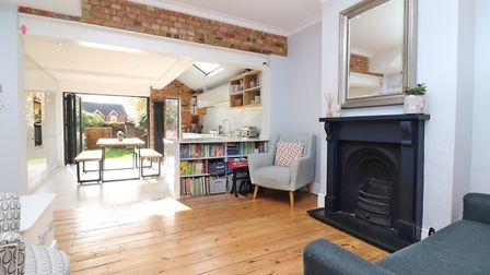 The family room benefits from a feature fireplace, a part exposed brick wall and natural flow into the bright and spacious...
