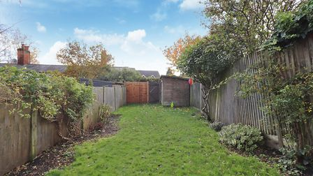 The 50ft rear garden offers a composite decked patio area leading to a generous lawn. Picture: Paul Barker Estate Agents