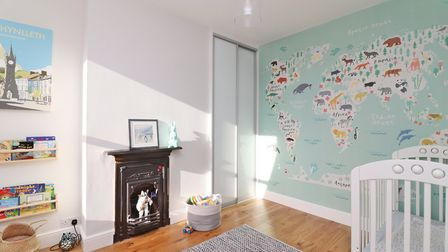 This first floor bedroom has a feature fireplace. Picture: Paul Barker Estate Agents