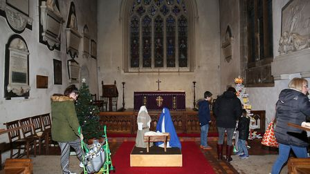 Visitors to the Christmas tree festival in St Mary's Church at the Baldock Christmas Fair in 2018. Picture: DANNY LOO