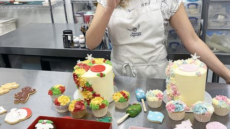 Lucy Clark of Heaven is a Cupcake with some of their delicious treats.