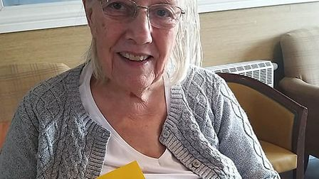Care Home resident with a card she made PICTURE: Country Court