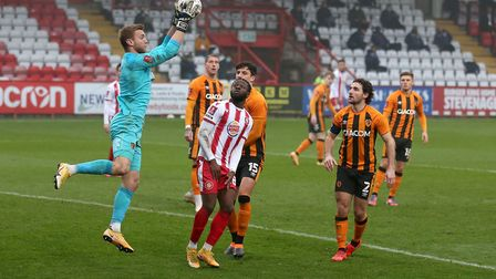 George Long of Hull City denies Aramide Oteh of Stevenage during Stevenage vs Hull City, Emirates FA Cup Football at the...