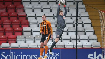Jamie Cumming of Stevenage denies Tom Eaves of Hull City in their FA Cup second round match. Picture: GAVIN ELLIS/TGS PHOTO