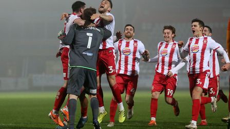 Stevenage players celebrate victory in the penalty shoot-out against Hull City in the FA Cup. Picture: GAVIN ELLIS/TGS PHOTO