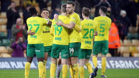 The Norwich players celebrate victory at the end of the Sky Bet Championship match at Carrow Road, N