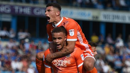 Carlton Morris and Ben Godfrey celebrates the striker's goal for Shrewsbury at Gillingham Picture: P