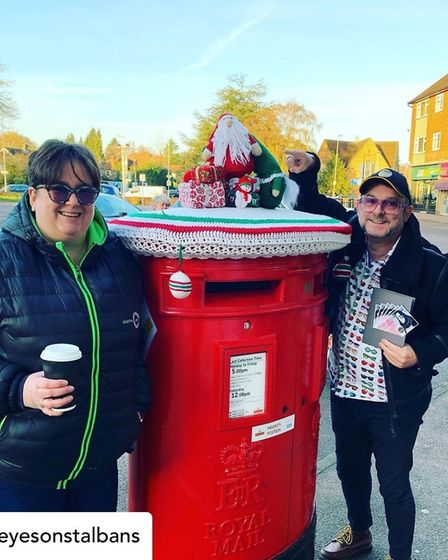 St Albans Postbox toppers have returned for Christmas. Jen Smith and Jez Levy with one of the boxes.