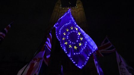 A European flag is lit up by anti-Brexit campaigners outside the Houses of Parliament. Photograph: K