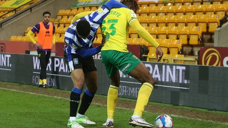Liam Palmer of Sheffield Wednesday and Tyrese Omotoye of Norwich in action during the Sky Bet Champi