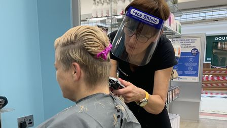 Stylists in full PPE cutting during client visit at Just Cuts, Stevenage. Picture: Supplied