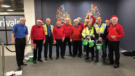 Kings of Herts barbershop chorus in jolly action at London Luton Airport last Christmas. Picture: Kings of Herts