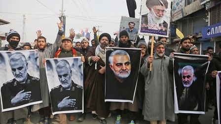 Kashmiri Shiite Muslims shout anti American and anti Israel slogans during a protest against U.S. ai