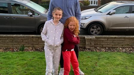 The Dunn sisters Amelie and Eva with their dad, Tobin. Picture: Helen Furse