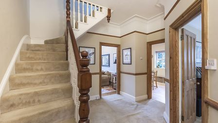 Three rooms lead off the spacious entrance hall. Picture: Hamptons