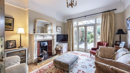 Doors from the living room lead out to the rear garden. Picture: Hamptons