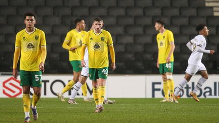 The Norwich players look dejected after conceding their side's 1st goal during the Papa Johns Trophy