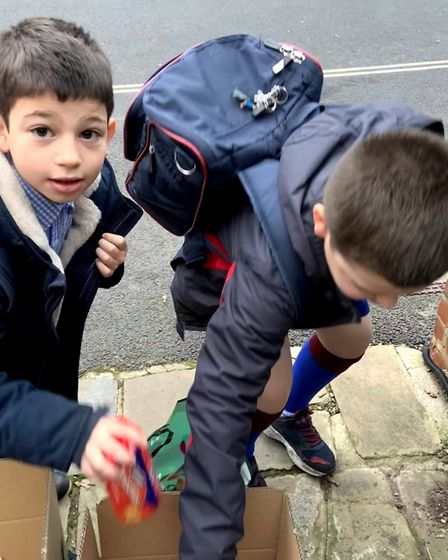 Boys from Lyndhurst House got stuck in to help out the Chalk Farm Food Bank. Picture: Lyndhurst House Prep