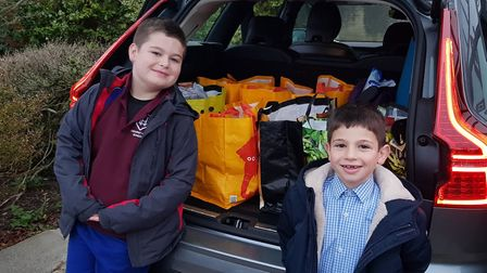 Families deliver hampers filled with vital items to the Chalk Farm Food Bank. Picture: Lyndhurst House Prep