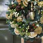 A traditonal wreath by Sayeh and Galton with mini protea and dried orange and lemon slices.