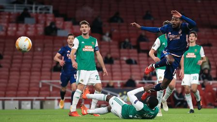 Arsenal's Ainsley Maitland-Niles (right) attempts a shot on goal during the UEFA Europa League Group B match at The...