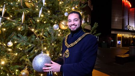 Mayor of Haringey Cllr Adam Jogee with the Muswell Hill Christmas Tree sponsored by traders from Muswell Business and...