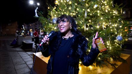 Muswell Hill vocalist Angie A sings a Christmas song as the Christmas Tree lights are turned on. Picture: Polly Hancock