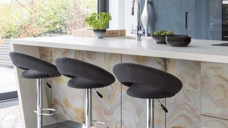 A waterfall island is when the counter material continues down the sides of the cabinets to create a cascading effect.