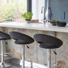 A waterfall island is when the counter material continues down the sides of the cabinets to create a cascading effect. Pictur...