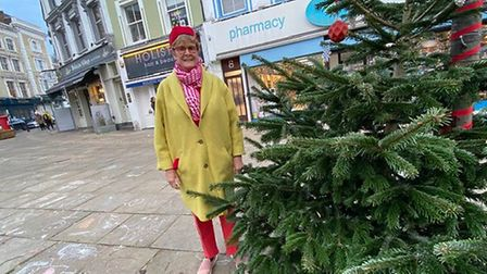 Linda Grove with the Christmas tree in Belsize Village. Picture: Linda Grove