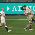 England's Owen Farrell (right) celebrates scoring his side's winning penalty kick in extra time with team-mates Tom Curry...