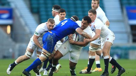 England's Billy Vunipola is tackled by France's Baptiste Pesenti (left) during the Autumn Nations Cup match at Twickenham...