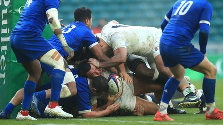 England's Ellis Genge (centre) tries to push the ball over the try line during the Autumn Nations Cup match at Twickenham...