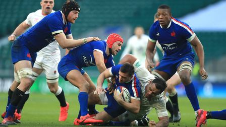 France's Baptiste Couiloud is tackled by England's Billy Vunipola during the Autumn Nations Cup match at Twickenham Stadium