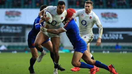 England's Anthony Watson is tackled by France's Brice Dulin (left) and Gabin Villiere during the Autumn Nations Cup match...