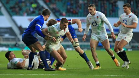 England's Henry Slade (centre) in action during the Autumn Nations Cup match at Twickenham Stadium
