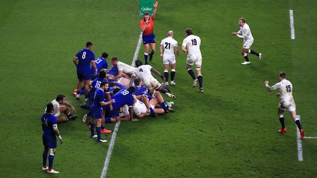 England's Luke Cowan-Dickie (hidden) scores his side's second try of the game