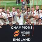 England's Owen Farrell (centre) lifts the Autumn Nations Trophy after victory in the final against France at Twickenham...