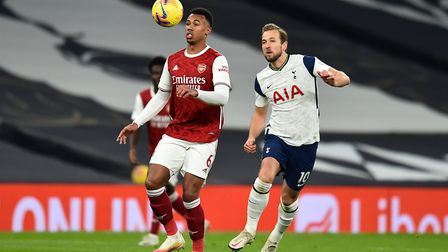 Arsenal's Gabriel Magalhaes (left) and Tottenham Hotspur's Harry Kane (right) battle for the ball