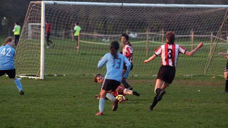 Clapton goalkeeper Polly Adams makes the block (Pic: Max Reeves)
