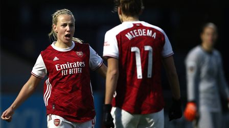 Arsenal's Beth Mead (left) celebrates scoring her side's first goal of the game during the FA Women's Super League match at M...